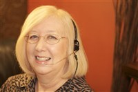 Bev Turner wearing head set