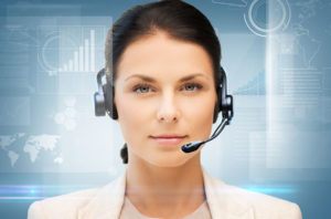 receptionist with headset on surrounded by digital graphics